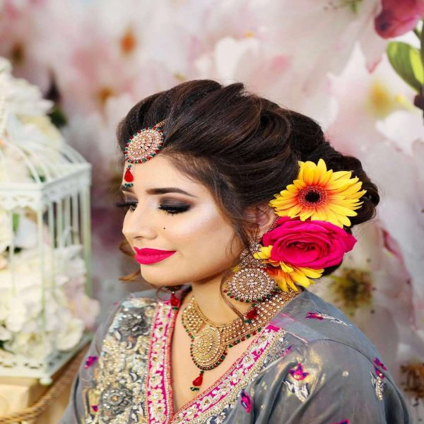 mehndi-bride-with-flowers-in-updo